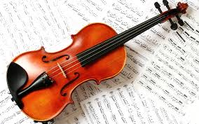 Violin Over Sheet Music